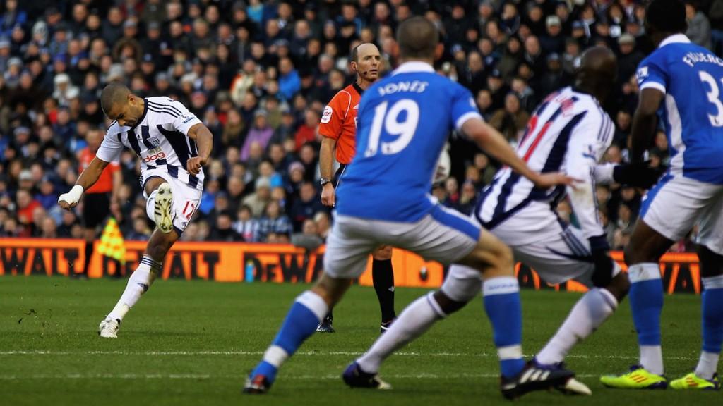 Reid (left) scores a free kick for West Bromwich Albion vs Wigan Athletic, Dec 10, 2011. Photo: Matthew Lewis / Stringer
