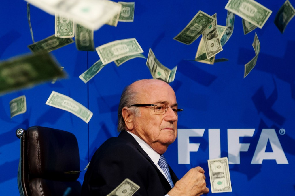Comedian Simon Brodkin (not pictured) throws fake dollar bills at Sepp Blatter during a press conference in Zurich, 2015. But does this image misrepresent the reality of the situation at FIFA? Photo: Philipp Schmidli / Stringer