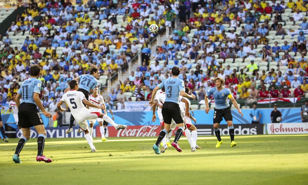 Clashing with Uruguay's Edinson Cavani. FIFA World Cup, 2014. Photo: Danilo Borges