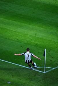 Joey Barton takes a corner for Newcastle. Photo: mth19