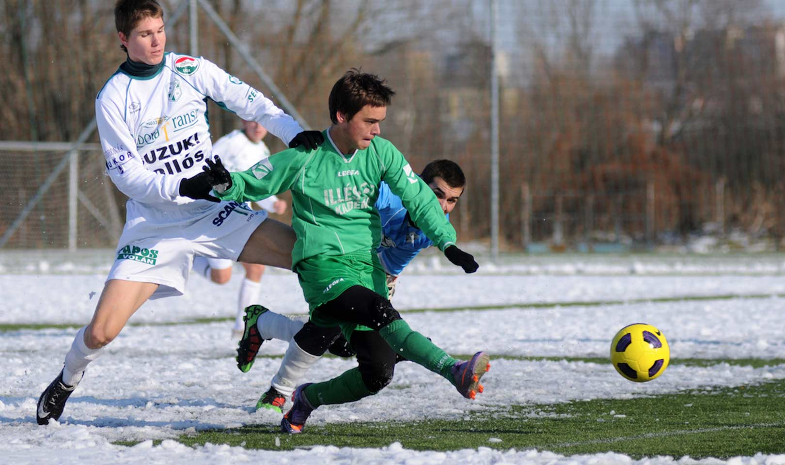 Kids playing football in the snow.