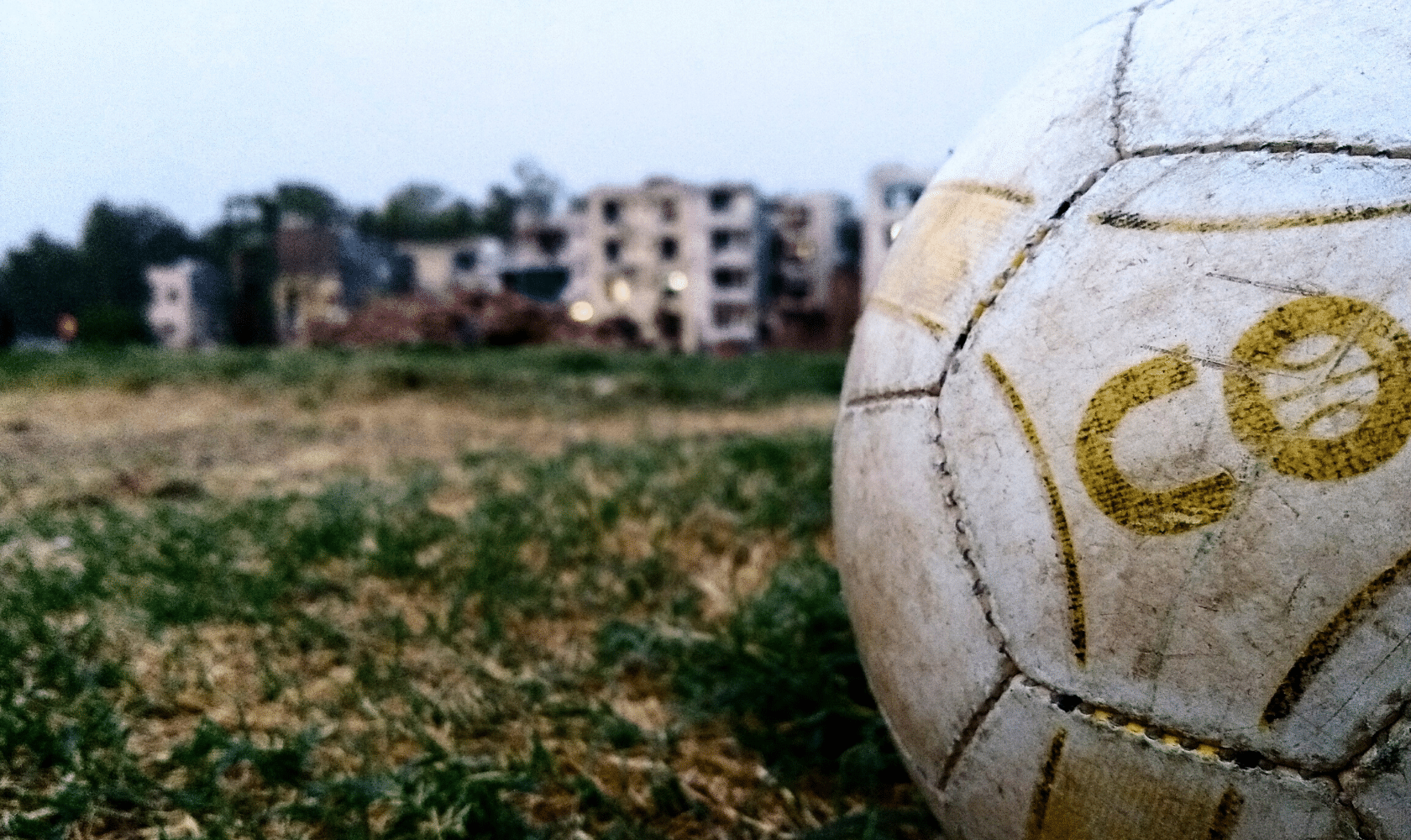 old soccer ball in field