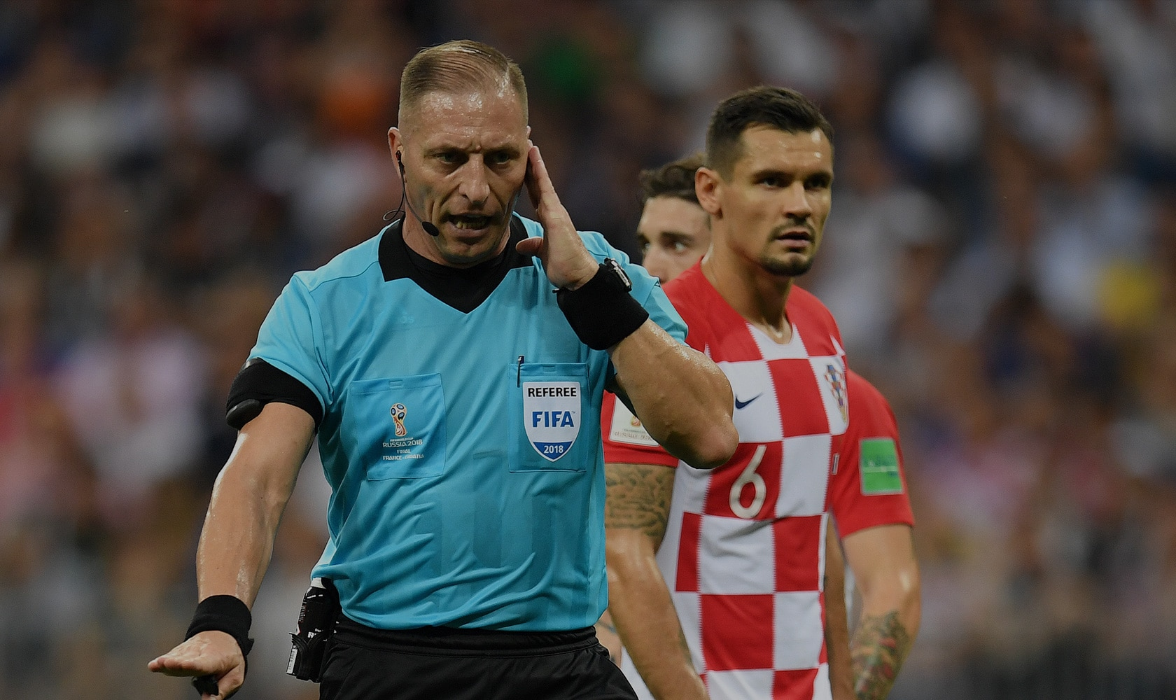MOSCOW, RUSSIA - JULY 15: Referee Nestor Pitana holds his hand to his ear before consulting VAR and consequently awarding France a penalty during the 2018 FIFA World Cup Final between France and Croatia at Luzhniki Stadium on July 15, 2018 in Moscow, Russia. (Photo by Matthias Hangst/Getty Images)