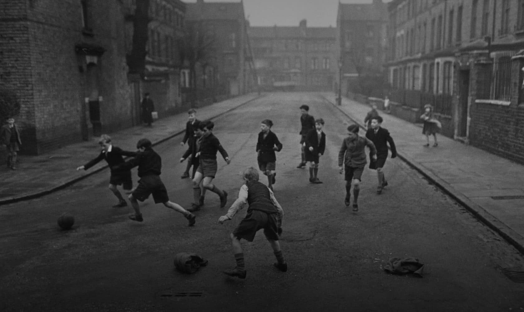 Kids play football in the street. London, April 1950. Photo: Haywood Magee / Stringer