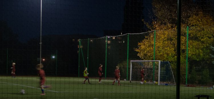 Kids play football at night. Photo: flickr/grotos