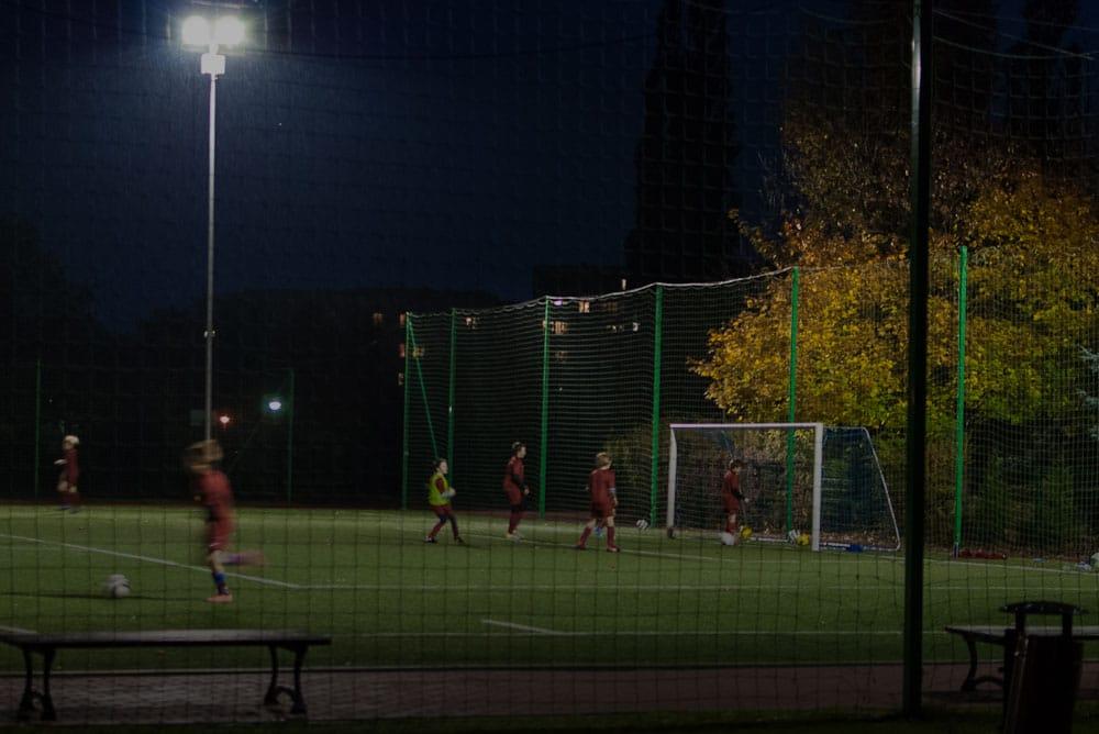 Kids play football at night. Photo: flickr/grotos