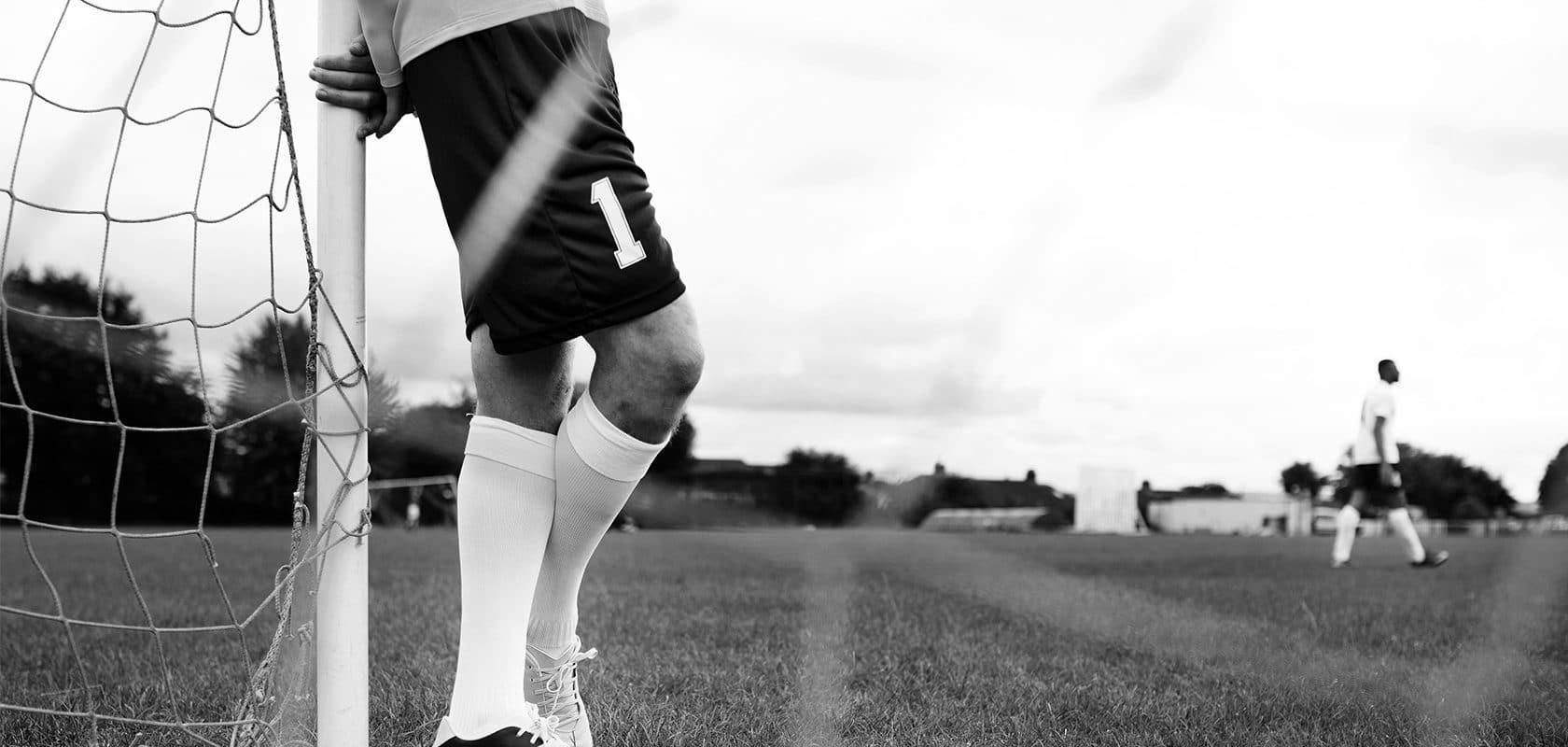 Soccer Player Standing Goal