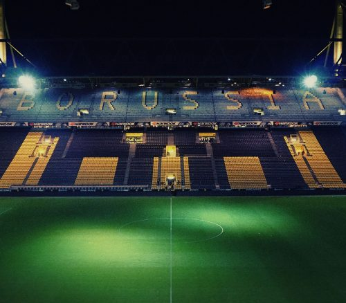 A night time view of the empty Borussia Dortmund stadium. Photo: Marvin Ronsdorf.