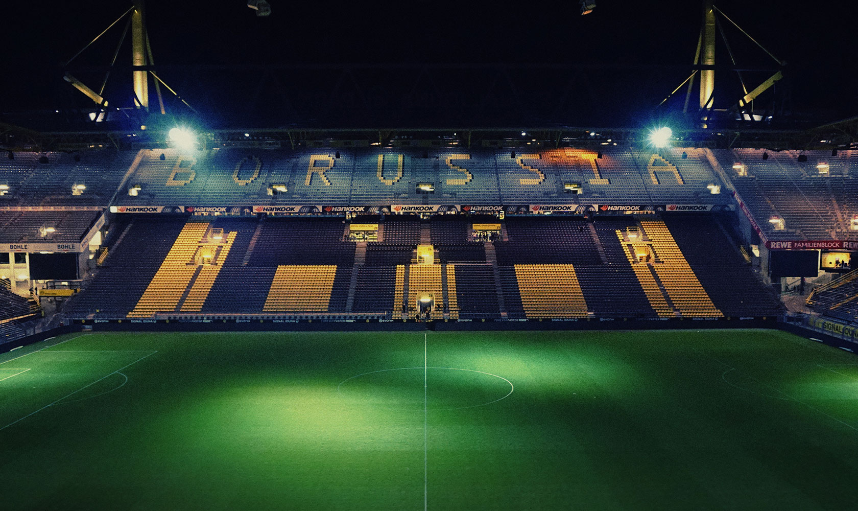 A night time view of the empty Borussia Dortmund stadium. Photo: Marvin Ronsdorf.