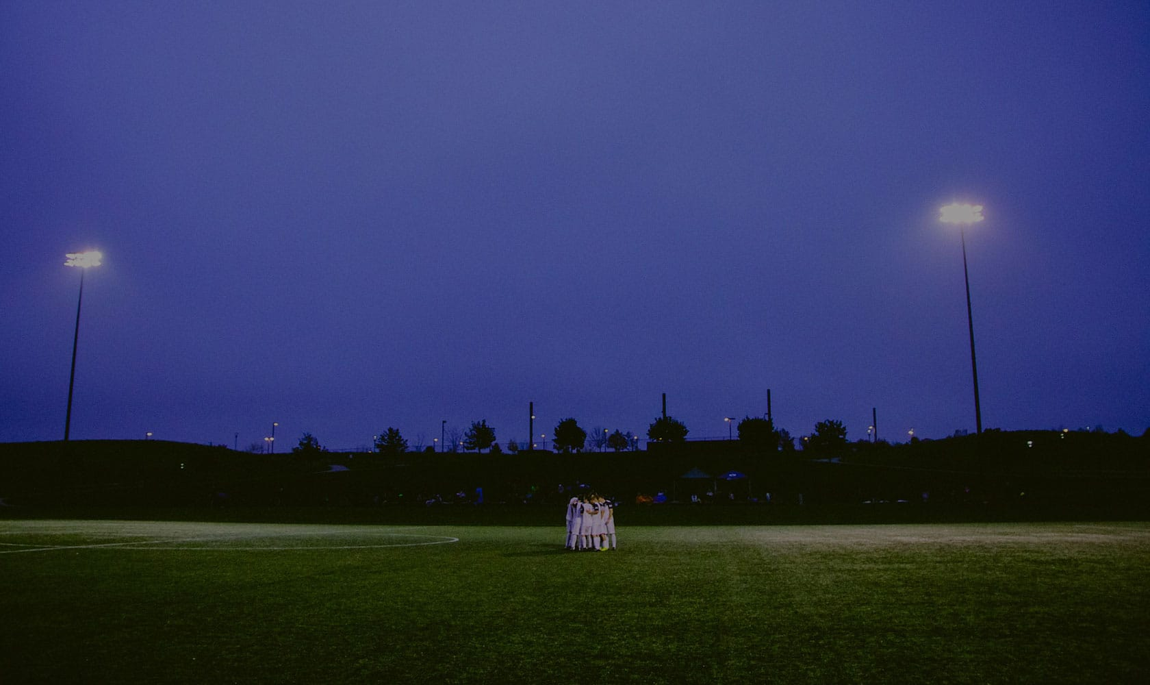 Huddle Under Lights
