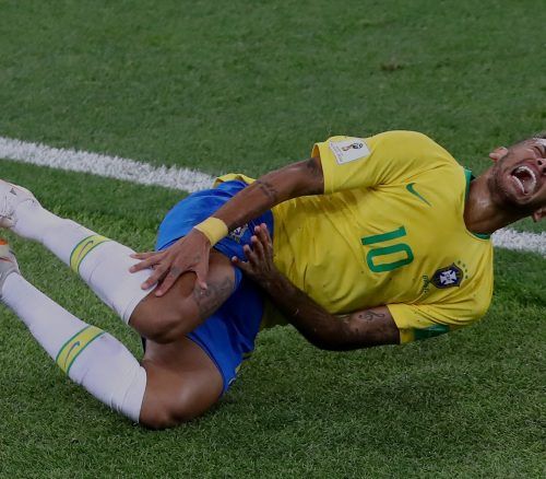 Serbia v Brazil: Group E - 2018 FIFA World Cup Russia MOSCOW, RUSSIA - JUNE 27: Neymar Jr of Brazil falls down after being fouled during the 2018 FIFA World Cup Russia group E match between Serbia and Brazil at Spartak Stadium on June 27, 2018 in Moscow, Russia. (Photo by Dean Mouhtaropoulos/Getty Images)