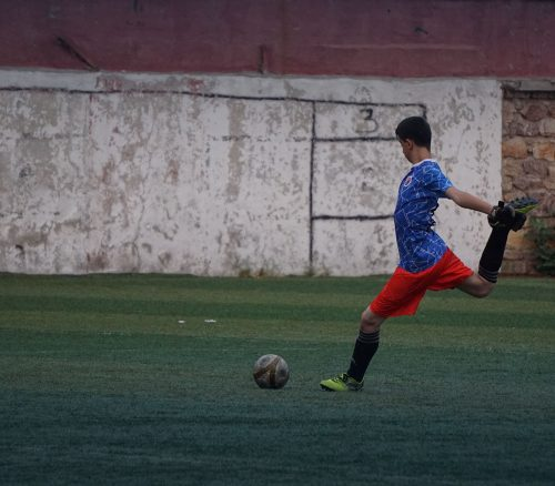 A lone soccer player strikes the ball. Photo: Yasar Kocal.