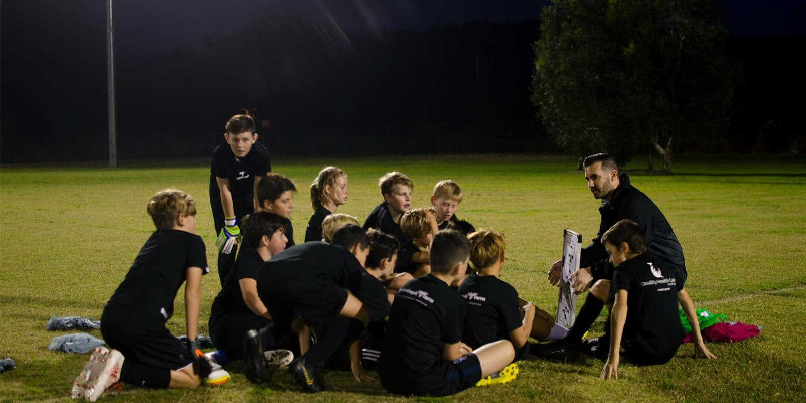 A football coach talking to his players.