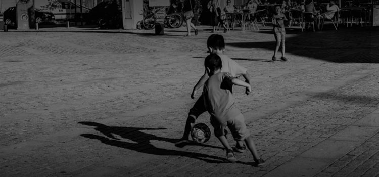 Kids play street football in Spain. Photo: Dani Vázquez